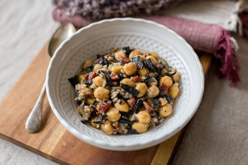 Chickpeas and rice with black trumpet mushrooms and iberico ham